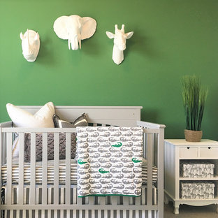 Design ideas for a medium sized rural gender neutral nursery in Sacramento with green walls, carpet and beige floors.