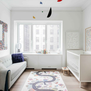 Nursery - mid-sized contemporary light wood floor and beige floor nursery idea in New York with gray walls