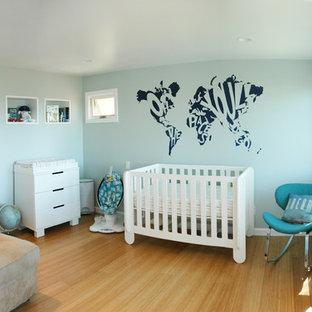 Mid-sized trendy boy bamboo floor nursery photo in Santa Barbara with blue walls