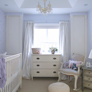 Design ideas for a mid-sized traditional nursery for girls in Toronto with purple walls, carpet and beige floor.