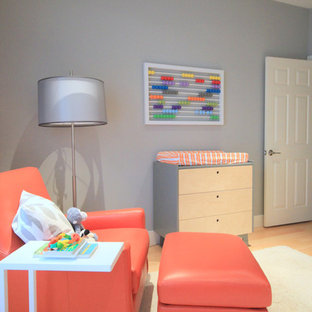 This is an example of a medium sized contemporary gender neutral nursery in Los Angeles with grey walls and light hardwood flooring.