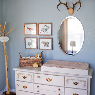 Inspiration for a medium sized rustic nursery for boys in Austin with blue walls and carpet.