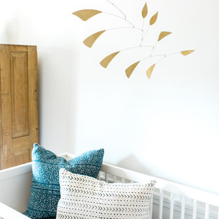Design ideas for a large bohemian gender neutral nursery in Boston with white walls and carpet.