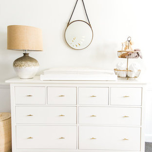 Inspiration for a large eclectic gender-neutral carpeted nursery remodel in Boston with white walls