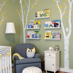 Medium sized traditional gender neutral nursery in Los Angeles with green walls and carpet.