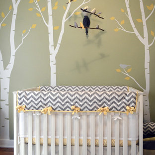 This is an example of a medium sized traditional gender neutral nursery in Los Angeles with green walls and carpet.