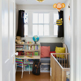 Inspiration for a small scandi gender neutral nursery in London with brown floors and white walls.