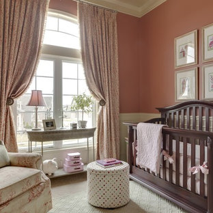Nursery - mid-sized traditional girl carpeted nursery idea in Kansas City with pink walls