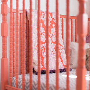 Example of a mid-sized transitional girl carpeted nursery design in Calgary with purple walls