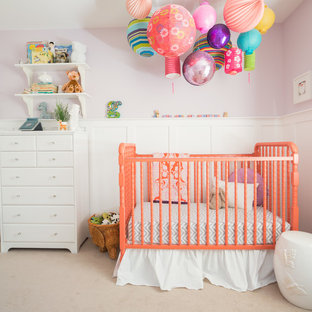 Medium sized traditional nursery for girls in Calgary with purple walls, carpet and beige floors.