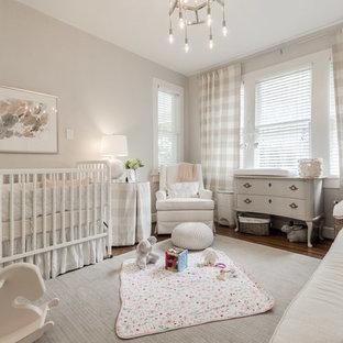 Farmhouse nursery for girls in Dallas with grey walls, dark hardwood flooring and grey floors.