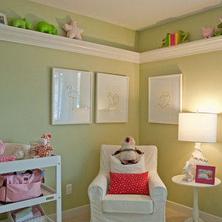 Inspiration for a medium sized eclectic gender neutral nursery in Vancouver with green walls, carpet and beige floors.