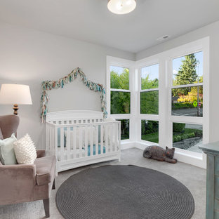 This is an example of a medium sized contemporary nursery for girls in Seattle with grey walls, carpet and grey floors.
