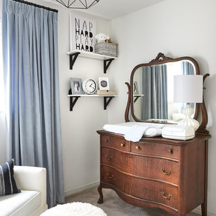Photo of a small traditional nursery for boys in Toronto with white walls.