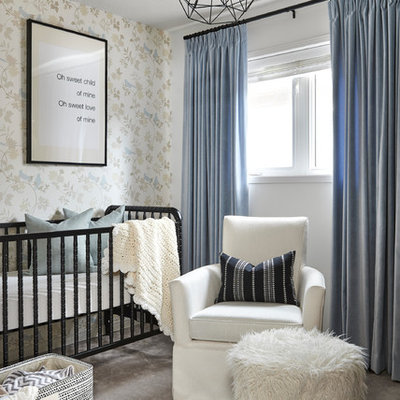 Nursery - small traditional boy carpeted and gray floor nursery idea in Toronto with multicolored walls
