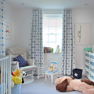 Photo of a traditional nursery for boys in London with white walls.