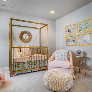 This is an example of a medium sized traditional nursery for girls in Salt Lake City with white walls, carpet and white floors.