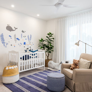 Inspiration for a beach style gender-neutral nursery in Gold Coast - Tweed with white walls and carpet.