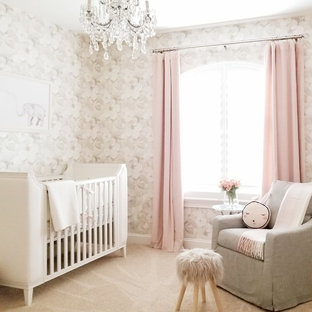 Example of a transitional carpeted and beige floor nursery design in Orlando with beige walls