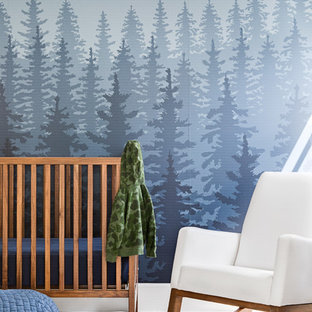 This is an example of a rustic nursery for boys in Orange County with blue walls and white floors.