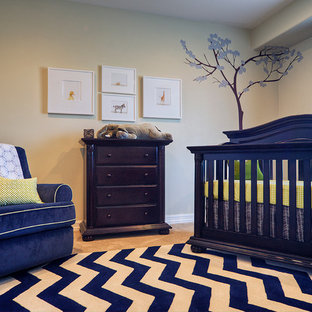 Mid-sized elegant boy carpeted nursery photo in Phoenix with beige walls