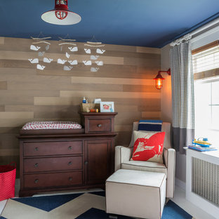 Transitional boy nursery photo in Boston with brown walls
