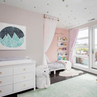 Nursery - mid-sized transitional dark wood floor and brown floor nursery idea in New York with gray walls