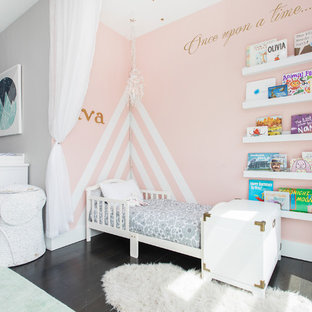 Inspiration for a mid-sized transitional dark wood floor and brown floor nursery remodel in New York with gray walls
