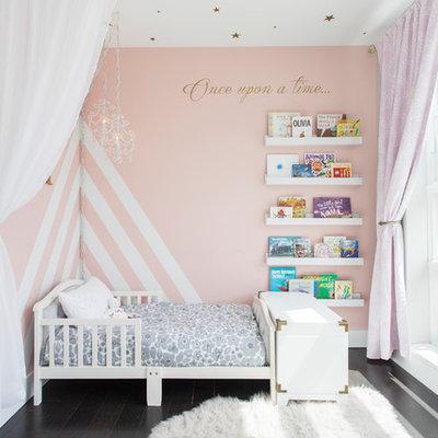 Nursery - mid-sized transitional girl dark wood floor and brown floor nursery idea in New York with gray walls