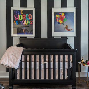 Photo of a medium sized contemporary nursery for girls in New York with multi-coloured walls, dark hardwood flooring and brown floors.