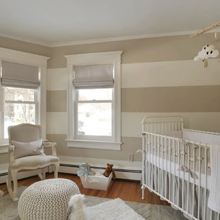 This is an example of a small traditional gender-neutral nursery in New York with medium hardwood floors and white walls.