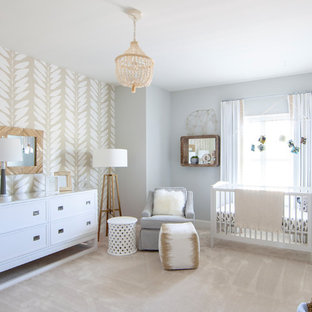 Transitional gender-neutral carpeted and beige floor nursery photo in Charlotte with gray walls