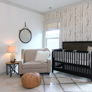 This is an example of a medium sized bohemian nursery for boys in Louisville with white walls and carpet.