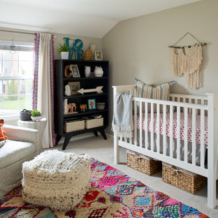 Bohemian nursery for girls in Denver with grey walls.