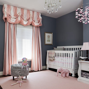 Design ideas for a medium sized traditional nursery for girls in Toronto with grey walls.