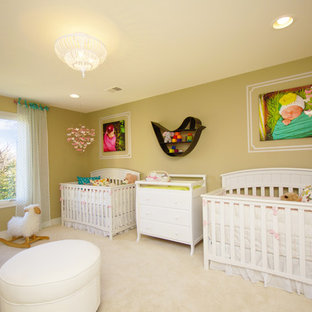 This is an example of a medium sized classic nursery for girls in Detroit with green walls and carpet.