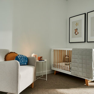 This is an example of a mid-sized contemporary gender-neutral nursery in Sydney with white walls, carpet and grey floor.