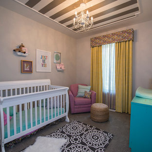 Design ideas for a small bohemian nursery for girls in Omaha with grey walls and carpet.
