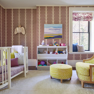 This is an example of a medium sized classic nursery for girls in Boston with dark hardwood flooring, brown floors and purple walls.