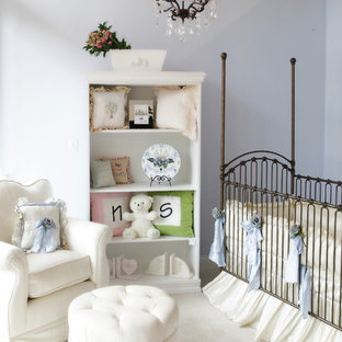 This is an example of a traditional gender-neutral nursery in Miami with purple walls and carpet.