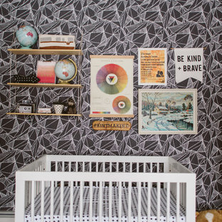 Example of an eclectic gender-neutral nursery design in Seattle with gray walls