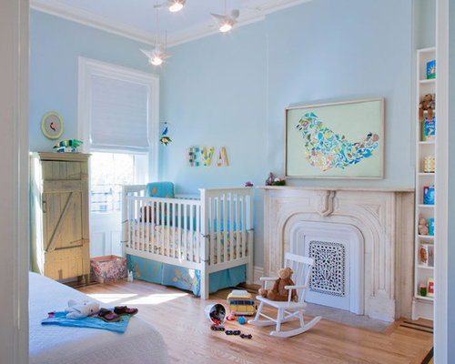 Example Of A Minimalist Gender Neutral Light Wood Floor Nursery Design In  Chicago With Blue