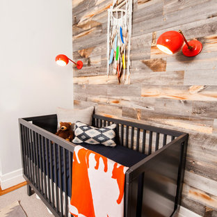 Inspiration for a rustic nursery for boys in New York with grey walls.