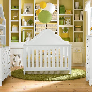 Inspiration for a traditional gender neutral nursery in Oklahoma City with yellow walls.