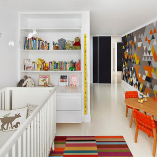 Photo of a contemporary gender-neutral nursery in Boston with multi-coloured walls and white floor.
