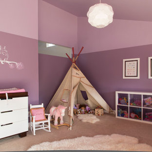 Example of a large minimalist nursery design in Denver
