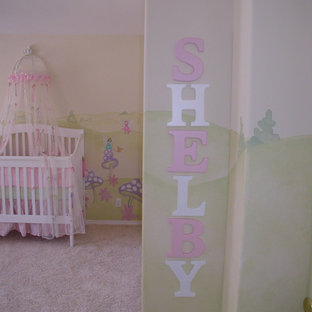 Design ideas for a medium sized traditional nursery for girls in Los Angeles with multi-coloured walls and carpet.
