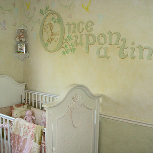This is an example of a medium sized classic nursery for girls in Los Angeles with multi-coloured walls and carpet.