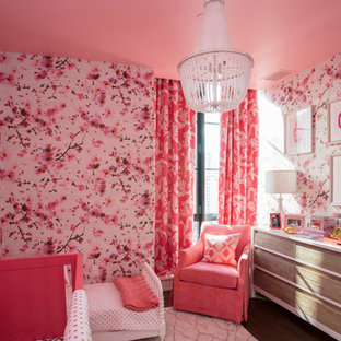 Large contemporary nursery for girls in New York with multi-coloured walls, dark hardwood flooring and brown floors.
