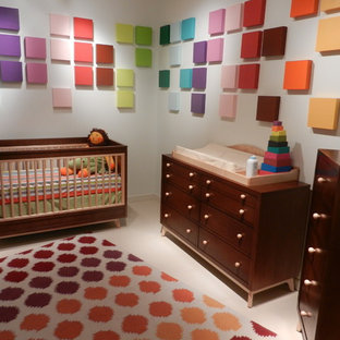Photo of a medium sized eclectic gender neutral nursery in Other.